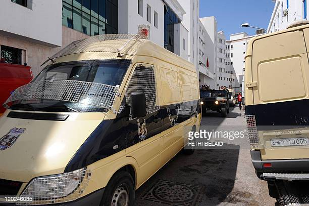 Tunisian soldiers escort vans bringing the family and Ben Ali Trabelsi for their 2nd trial of ousted Tunisian President Zine El Abidine Ben Ali at a...