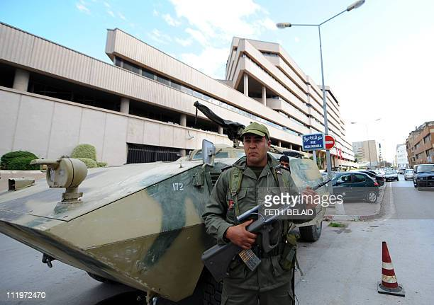 Tunisian soldiers guard on February 16 2011 the headquarters of the Tunisian Central Bank in Tunis before bank Governor Mustapha Kamel Nabli gives a...