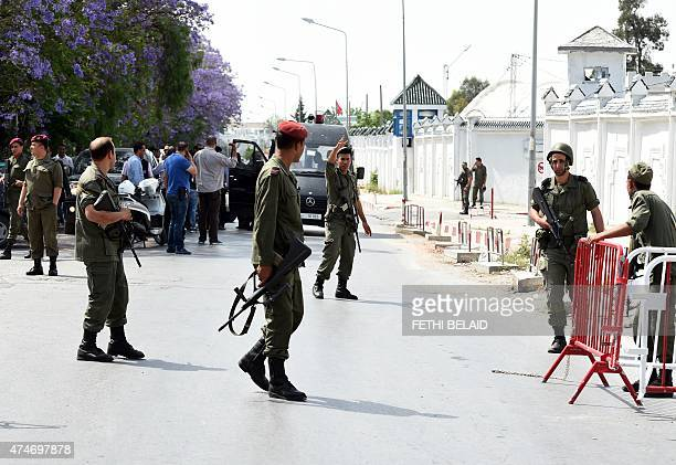 Tunisian soldiers stand guard outside the Bouchoucha army barracks in Tunis on May 25 2015 after a soldier opened fire at his colleagues A Tunisian...
