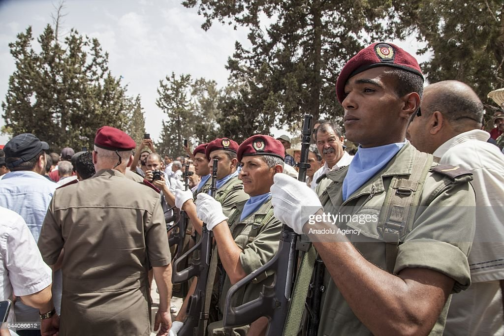 Tunisian soldiers stand in silence during a funeral ceremony of Tunisian Brigadier General Fathi Bayoud who lost his life during a terrorist attack at the Ataturk International Airport in Istanbul, at Ksour Essef town in Mahdia, Tunisia on July 1, 2016.