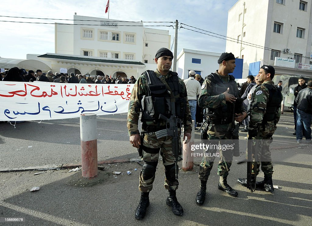 Tunisian special forces stand guard outside the Manouba court during the trial of the dean of the faculty of arts, letters and humanities at Manouba University, Habib Kazdaghli, accused of slapping a female student wearing an Islamic veil, on January 3, 2013. Kazdaghli, whose trial has gripped Tunisia for months amid bristling tensions between secularists and hardline Salafists, attended a new hearing in the case. AFP PHOTO / FETHI BELAID
