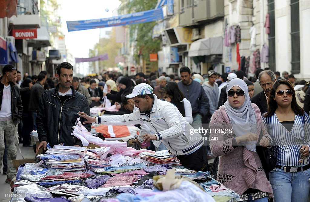 A Tunisian street vendor displays his goods on Spain Avenue on March 11, 2011 in Tunis. The Tunisian military and police made efforts to clear out unlicenced street vendors today. Since the flight of President Ben Ali, illegal sellers have profited from a lack of disorder in the Tunisian capital, crowding the streets with makeshift stands to hawk their wares. AFP PHOTO / FETHI BELAID