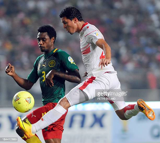 Tunisian striker Amine Chermiti vies with Cameroon's defender Ndoubena Nkoulou during the FIFA World Cup qualification match between Tunisia and...