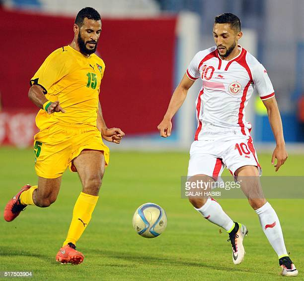 Tunisian striker Mohamed Wael Balaebi vies for the ball with Togo's forward Romao Maixys during the African Cup of Nations 2017 qualifying football...