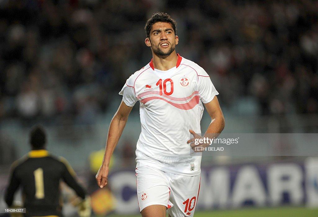 Tunisian striker Oussama Darragi jubilates after scoring against Serra Leone on March 23, 2013 in Rades stadium during their 2014 World Cup qualifying football match. Tunisia won 2-1.