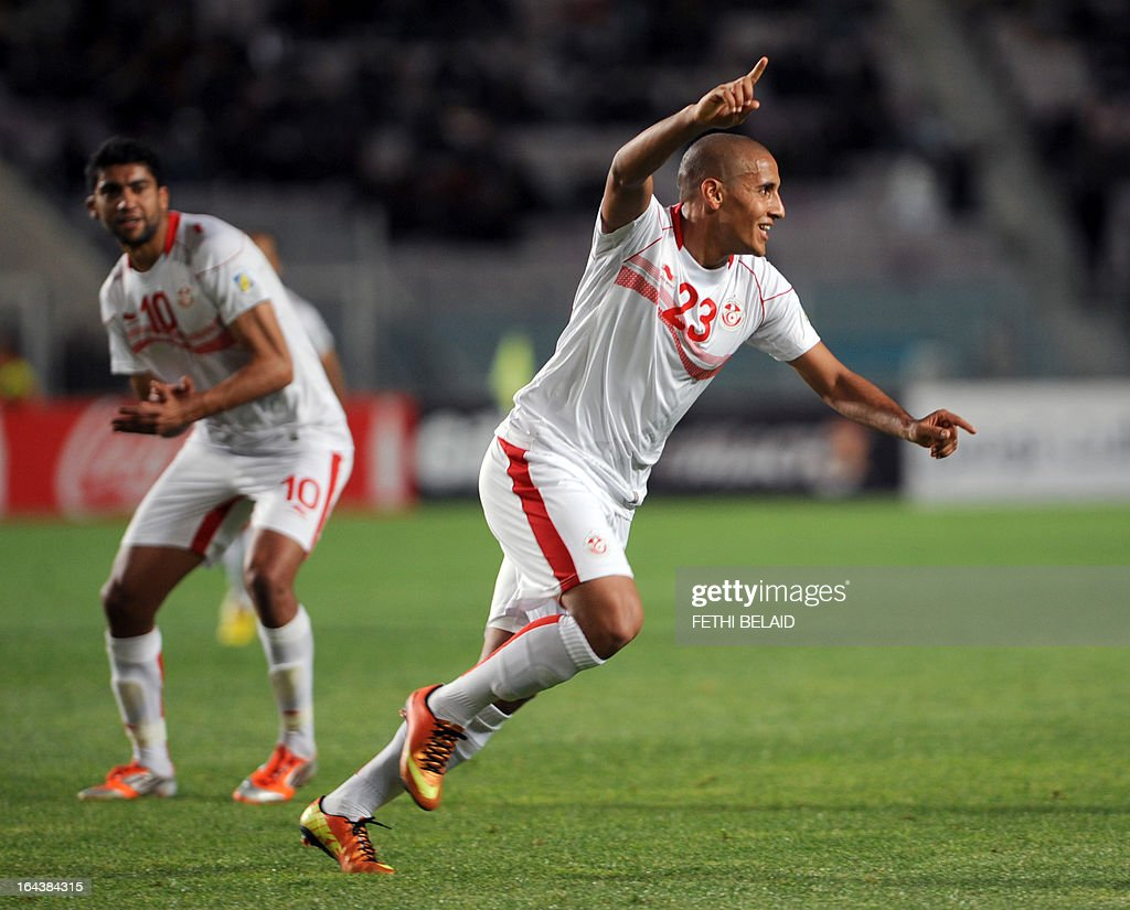 Tunisian striker Wahbi Kharzi (R) jubilates after scoring against Serra Leone on March 23, 2013 in Rades stadium during their 2014 World Cup qualifying football match. Tunisia won 2-1.