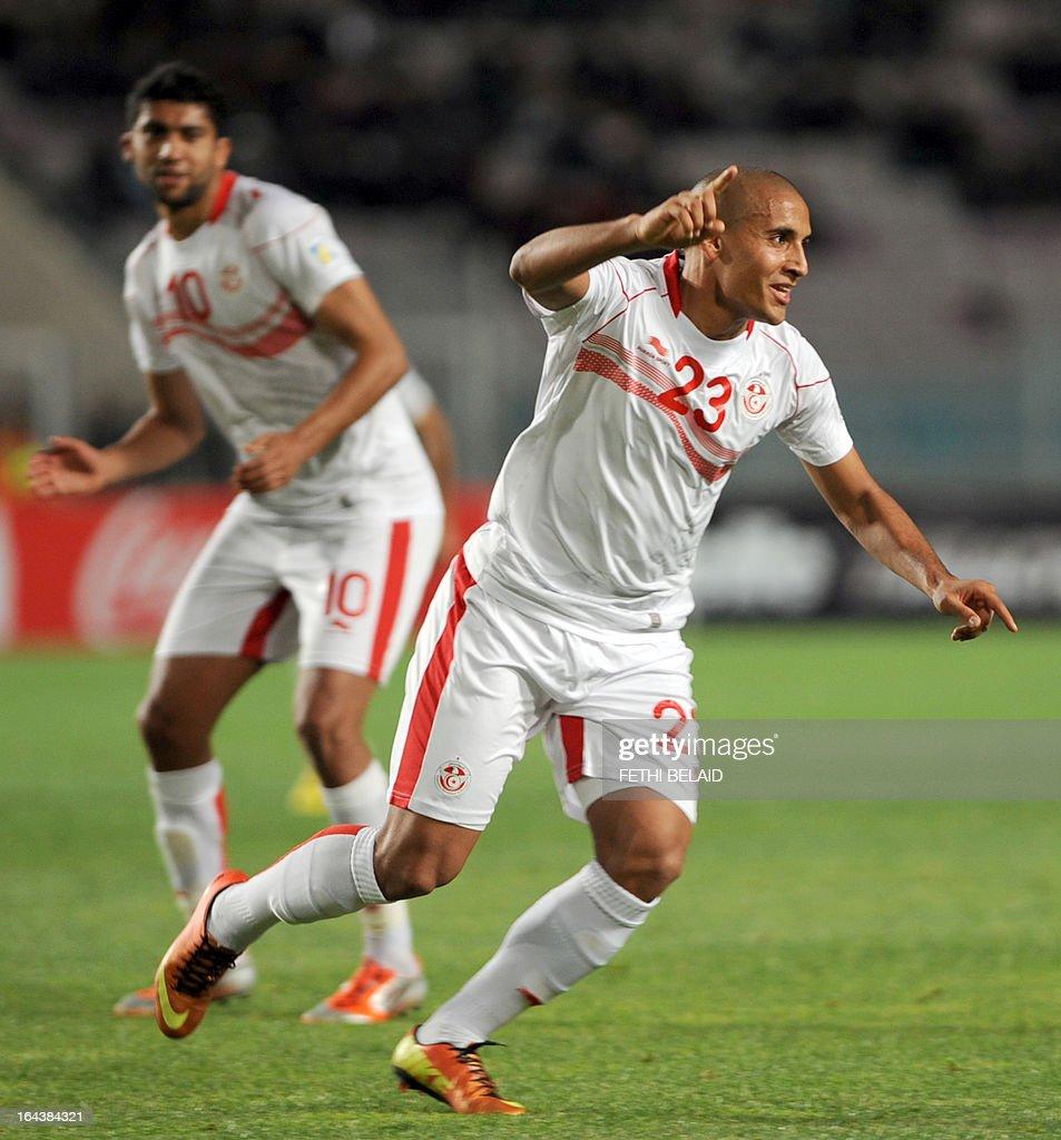 Tunisian striker Wahbi Kharzi (R) jubilates after scoring against Serra Leone on March 23, 2013 in Rades stadium during their 2014 World Cup qualifying football match. Tunisia won 2-1.
