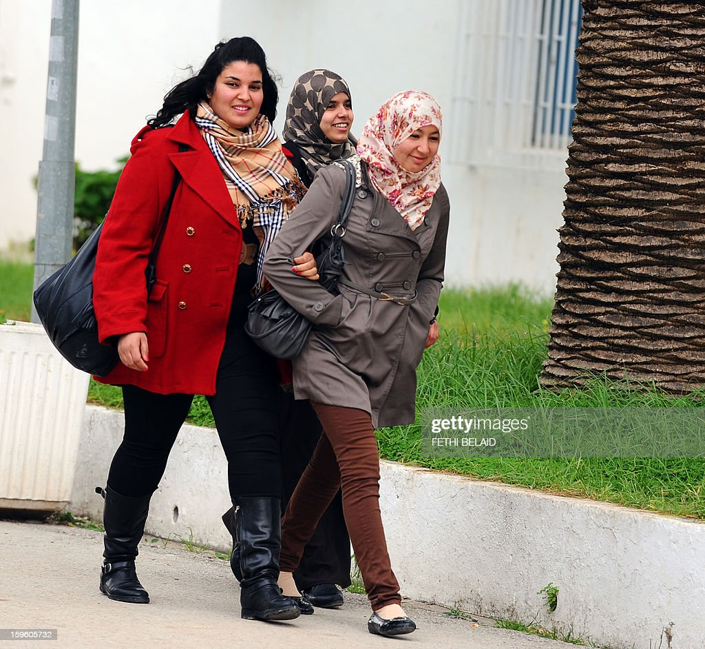 Tunisian students walk at the Manouba Faculty of Arts, Letters, and Humanities on January 17, 2013, outside Tunis. The dean of the faculty, Habib Kazdaghli is accused of slapping a female student wearing an Islamic veil. The court, which was supposed to give its verdict today, has postponed his decision to March 28, 2013.
