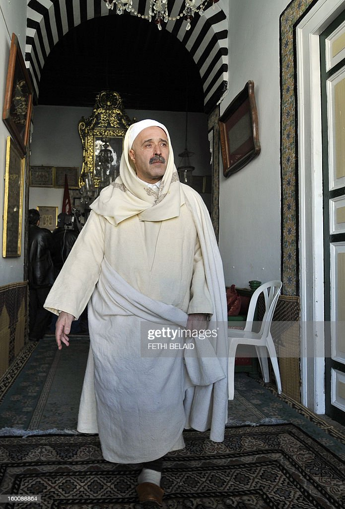 A Tunisian Sufi man walk along a hallway in the shrine of Sidi Belhassen Chedly on January 26, 2013, in Tunis, following prayers. Tunisia's government has promised to implement 'emergency' measures to protect Sufi Muslim mausoleums, which have been targeted in a number of suspected hardline Islamist attacks, the culture minister said. AFP PHOTO / FETHI BELAID Sufi leaders soretent the mausoleum of Sidi Bellahsen Chadly after having completed their weekly ritual on January 26, 2013 in Tunis. The Tunisian government has promised to day measures 'emergency' to protect Sufi shrines covered by dozens of attacks, an announcement Saturday called 'positive' by the Union but tradive Sufi Tunisia accuses Salafi factions of these rampages .