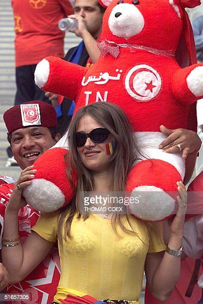 Tunisian supporter shares a joke with a Romanian fan 26 June on the stands of the Stade de France in SaintDenis near Paris before the 1998 Soccer...