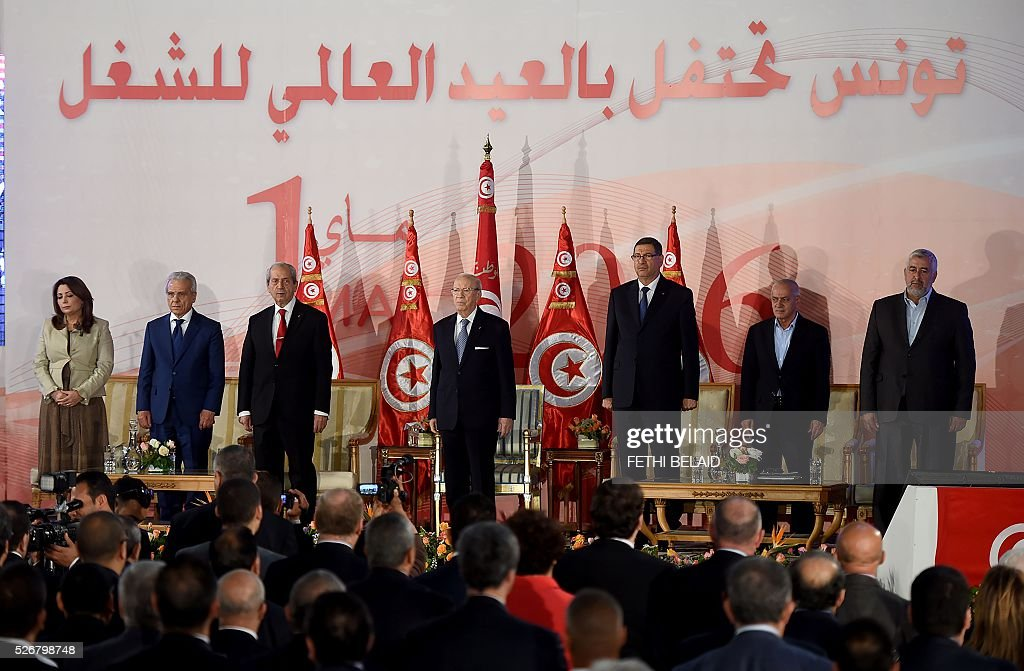 Tunisian President Beji Caid Essebsi (C-L) and prime minister Habib Essid (C-R) attend a May Day celebration on May 1, 2016 in the capital Tunis. / AFP / FETHI