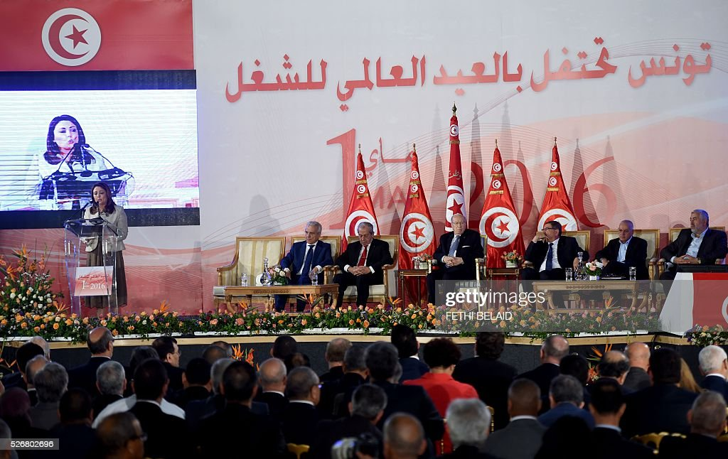 Tunisian Union of Industry, Trade and Handicrafts (UTICA) President and Nobel peace price laureate Wided Bouchammaoui (L) delivers a speech during May Day celebrations on May 1, 2016 in the capital Tunis. / AFP / FETHI