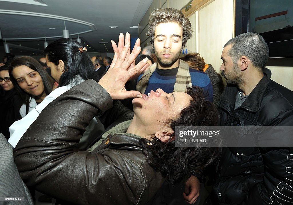 A Tunisian woman mourns after the killing of Tunisian opposition leader and outspoken government critic Chokri Belaid, on February 6, 2013 at the clinic in Tunis. Belaid was gunned down outside his home in Tunis, sparking angry protests by his supporters and attacks on offices of the ruling Islamist Ennahda party.