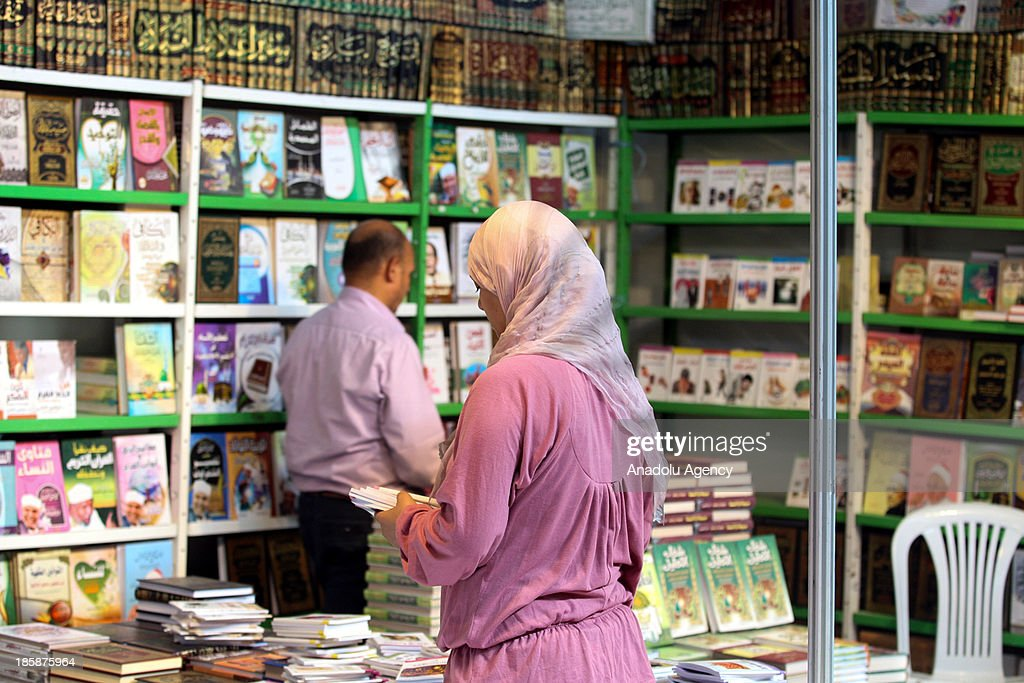 A Tunisian woman takes a look at the books at the 30th edition of the Tunis International Book Fair that opens on October 25, 2013 in Tunis, Tunisia. 10 day event will host a thousand publishers from 31 countries.