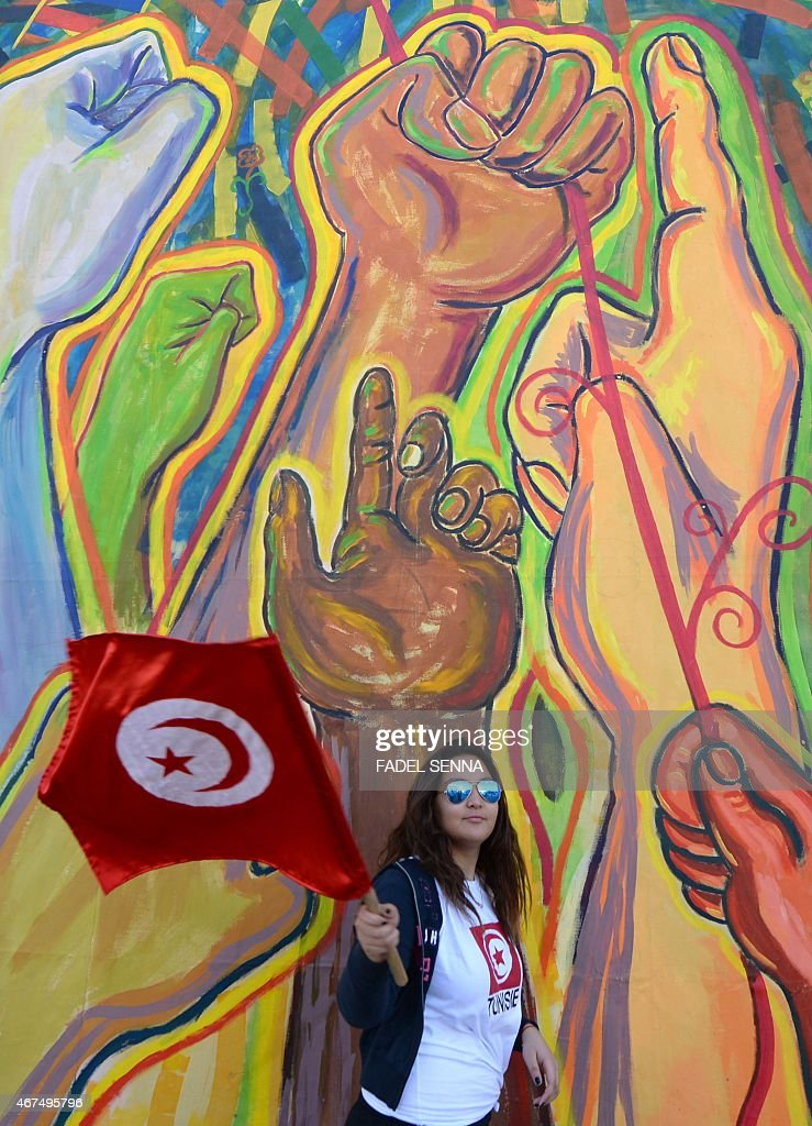 A Tunisian woman waves her national flag as international activists gather for the World Social Forum in Tunis on March 25 2015 The WSF is an annual...