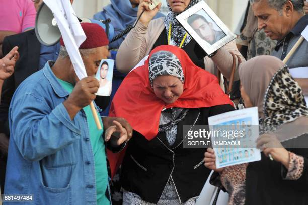 A Tunisian woman who had lost her son in the Mediterranean sea as he attempted to cross into Europe by boat collapses during a demonstration in Tunis...