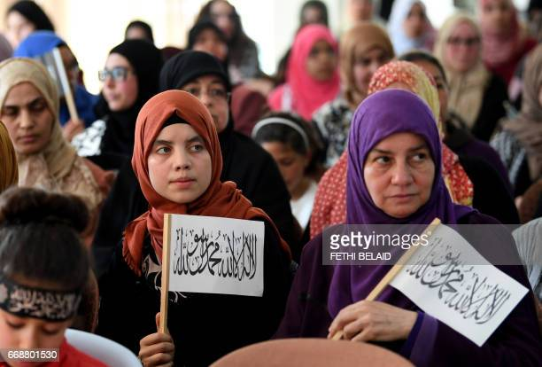 Tunisian women members of the radical Islamist party Hizb utTahrir attend a speech at the party headquarters on April 15 in the Tunis suburb of...