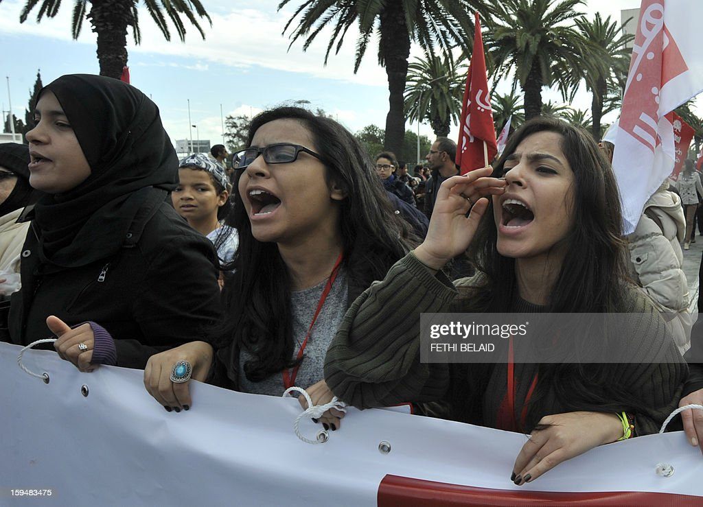 Tunisian women shoot slogans during a gathering as part of the festivities marking the second anniversary of the uprising that ousted long-time dictator Zine El Abidine Ben Ali on January 14, 2013 in Tunis. Tunisians marked two years since the revolution amid a climate of uncertainty marked by social tension, a weak economy, threats from jihadists and a political impasse.