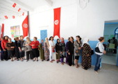 Tunisian women wait in line to vote for the municipal elections in Tunis on May 9 2010 Polls opened in Tunisia Today for municipals elections in...