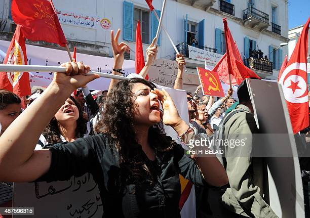 Tunisian workers from UGTT Tunisian General Labour Union shout slogans as they attend a May Day rally on May 1 2014 in Tunis AFP PHOTO / FETHI BELAID