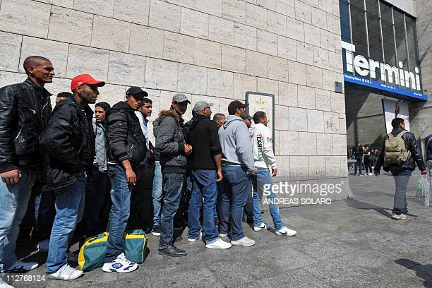 Tunisian wouldbe immigrants wait before boarding a train at Rome's Termini station to Ventimiglia the Italian border town with France on April 21...