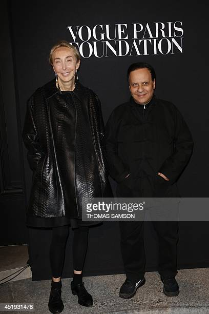 Tunisianborn designer Azzedine Alaia poses on July 9 2014 with a friend at the 'Vogue Paris Foundation' party in Paris AFP PHOTO / THOMAS SAMSON
