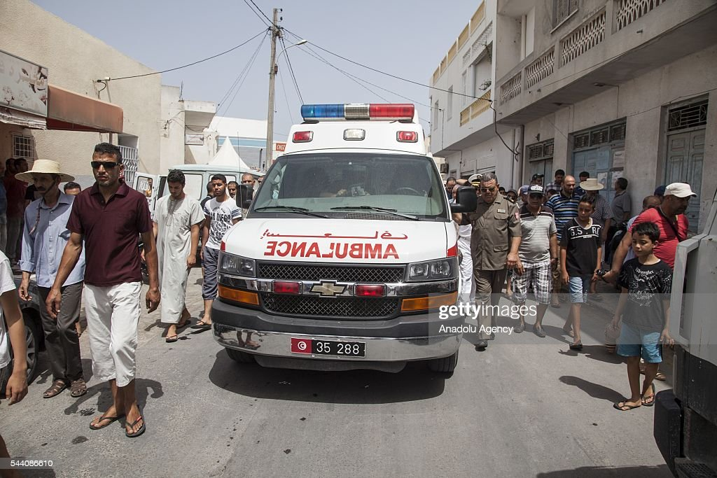 Tunisians are seen around an ambulance during a funeral ceremony of Tunisian Brigadier General Fathi Bayoud who lost his life during a terrorist attack at the Ataturk International Airport in Istanbul, at Ksour Essef town in Mahdia, Tunisia on July 1, 2016.