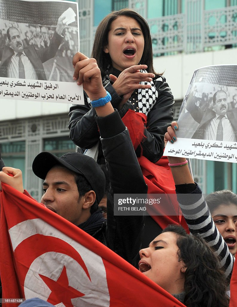 Tunisians attend a demostration in solidarity with Basma Khalfaoui Belaid following the assassination of her husband Chokri Belaid in front of the National Constituent Assembly on February 11, 2013 in Tunis. Prime Minister Hamadi Jebali's gamble on forming a new government in defiance of his own Islamist party after the assassination of opposition head Chokri Belaid left Tunisia in political limbo.