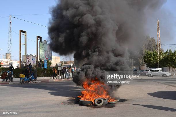 Tunisians burn tires in Ben Gardane on February 4 2015 when a protest against the border tax adjustment between Libya and Tunisia