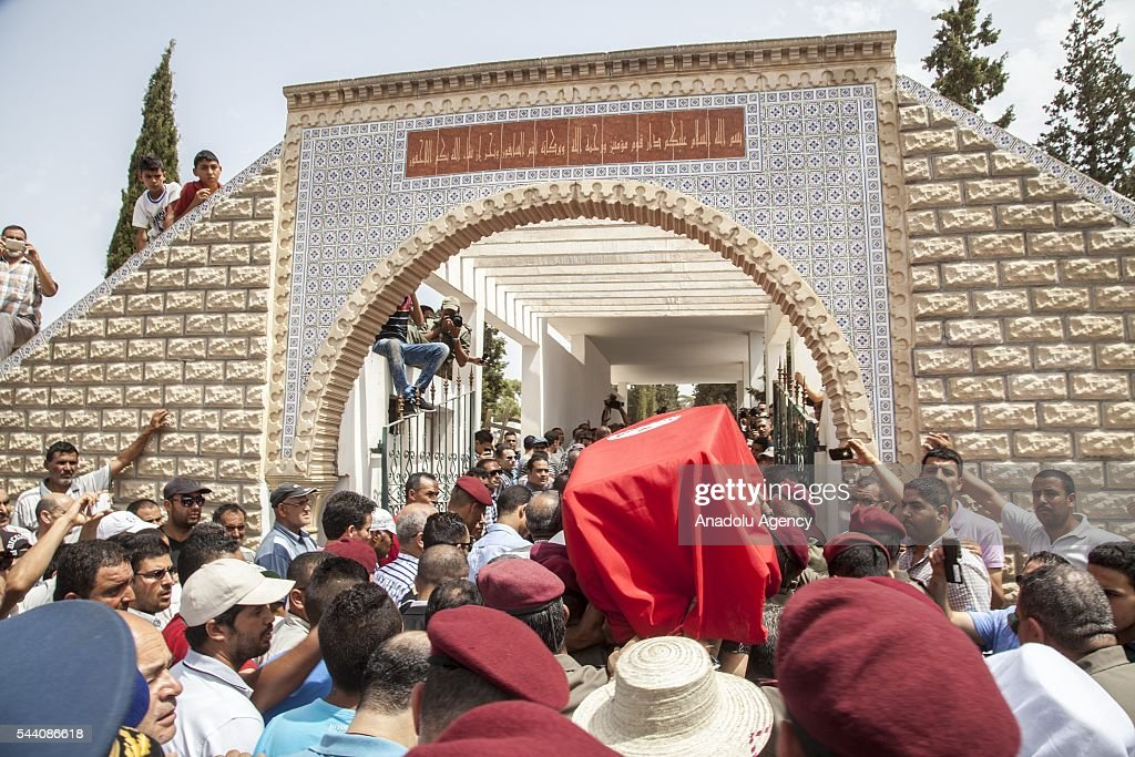Tunisians carry the body of Tunisian Brigadier General Fathi Bayoud who lost his life during a terrorist attack at the Ataturk International Airport in Istanbul, during a funeral ceremony at Ksour Essef town in Mahdia, Tunisia on July 1, 2016.