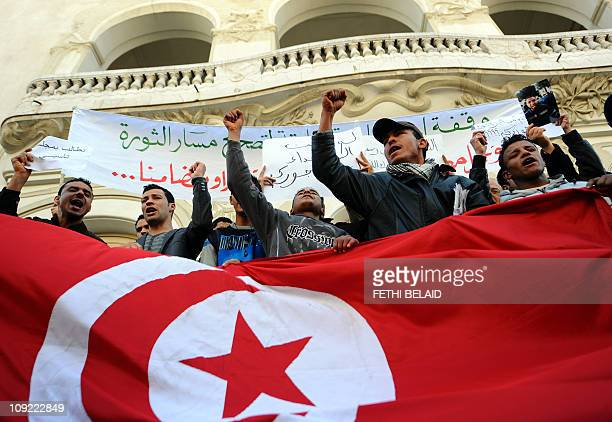 Tunisians celebrate the anniversary of the first month of the Tunisian revolution on February 14 2011 in Habib Bourguiba Avenue in Tunis Some 5000...