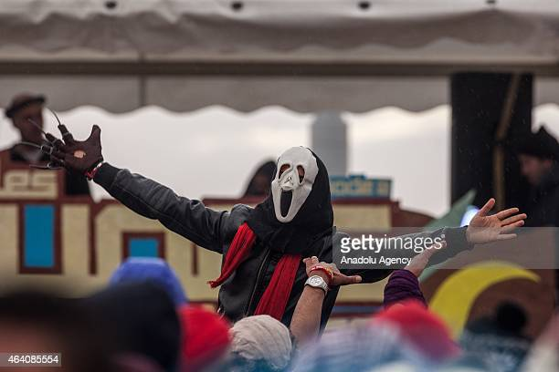 Tunisians dance at the electronic music festival 'Les Dunes Electroniques' on February 21 2015 at Ong Jmel near the town of Nefta where one of the...