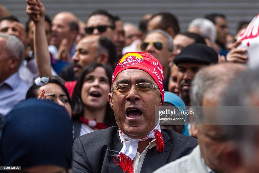 Tunisians gather outside the headquarters of the Tunisian General Labour Union UGTT to attend a May Day Rally in Tunis, Tunisia on May 1, 2016.