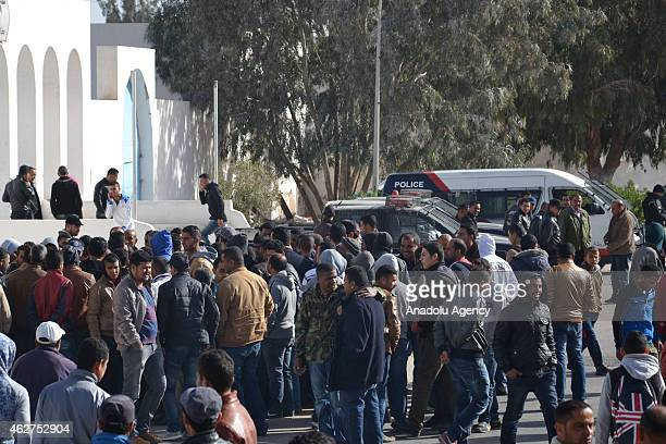 Tunisians gather outside the police headquarters in Ben Gardane on February 4 2015 when a protest against the border tax adjustment between Libya and...