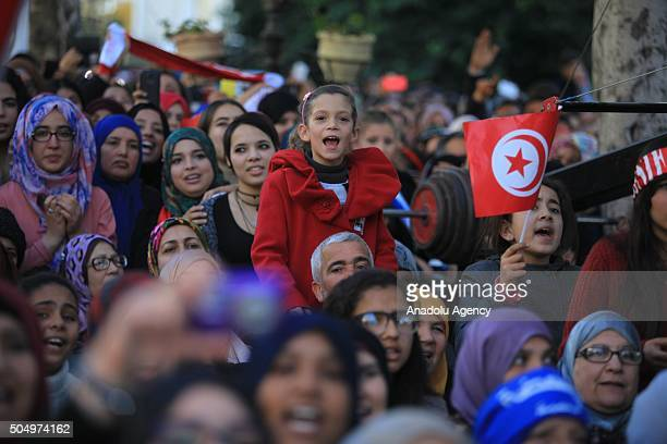 Tunisians listen to Lebanese origin Swedish singer Maher Zain during a concert at the Habib Bourguiba street as part of the celebrations of the 5th...