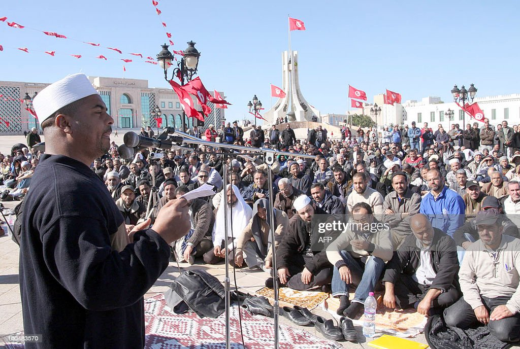 Tunisians listen to the speech of a victim of the former regime during a rally in the Kasbah square on the occasion of the implementation of the first legislative decree since the revolution on February 1, 2013 in Tunis. Imprisoned, tortured or raped in the former regime's prisons, Tunisian women broke the silence to demand justice, more than two years after the revolution.