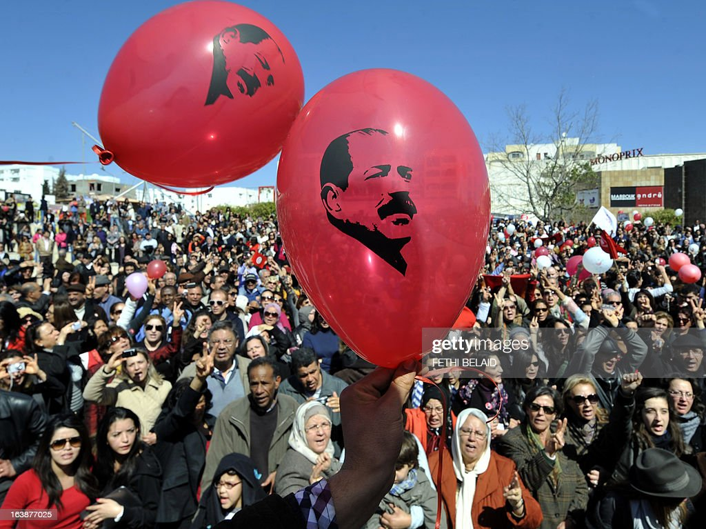 Tunisians release balloons bearing portraits of slain opposition leader Chokri Belaid outside his house in Tunis on March 17, 2013 as they mark 40 days since his killing. Belaid, a critic of the ruling Islamists whose death plunged Tunisia into turmoil, was gunned down outside his home on February 6 in a killing blamed by the authorities on radical Islamists, denying any involvement. Several arrests in the case have been made, but the suspected killer remains at large.
