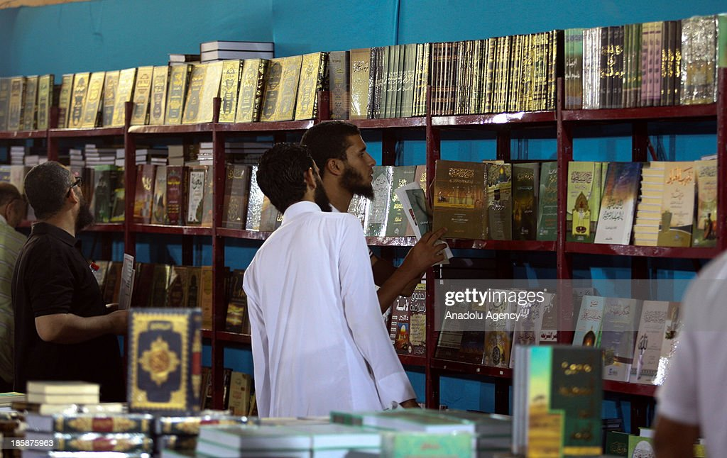 Tunisians take a look at the books at the 30th edition of the Tunis International Book Fair that opens on October 25, 2013 in Tunis, Tunisia. 10 day event will host a thousand publishers from 31 countries.