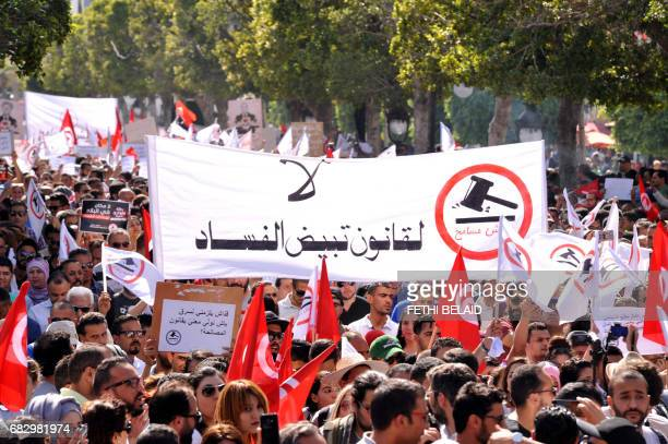 CORRECTION Tunisians take part in a demonstration against corruption on May 13 2017 in the capital Tunis against a bill that would allow officials...