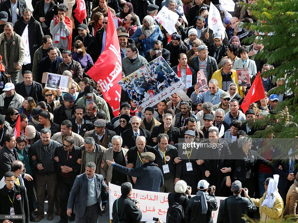 Tunisians walk towards El-Jellaz cemetery before gathering at the tomb of the anti-Islamist opposition leader Chokri Belaid to mark the 40th day of mourning after his death on March 16, 2013 in a suburb of Tunis. Belaid was gunned down outside his Tunis home on February 6, with the broad daylight killing sparking clashes between protesters and police and prompting the largest anti-government demonstrations since the revolution.