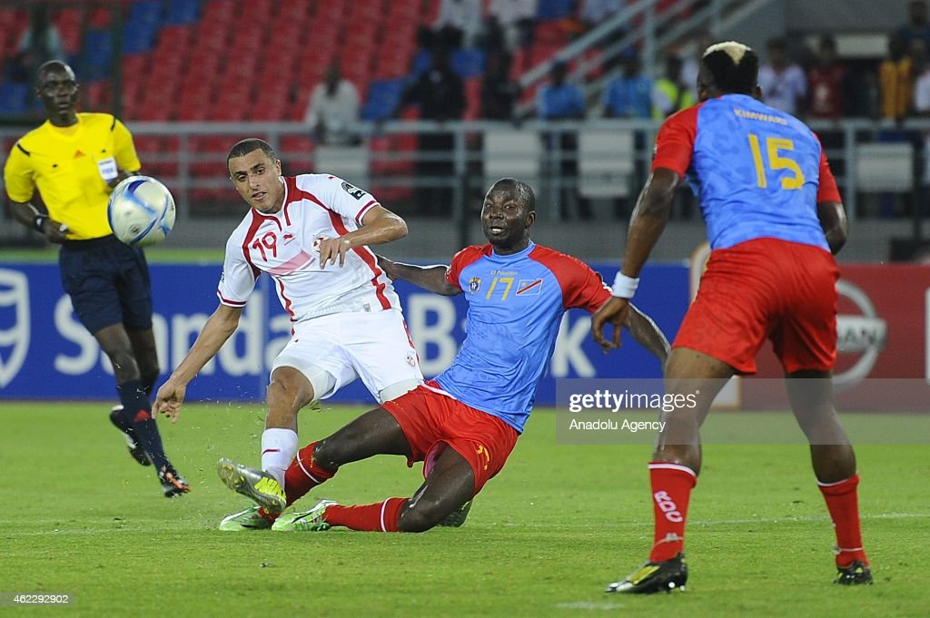 Tunisia's Ahmed Akaichi (L) in action against Congo's <a gi-track='captionPersonalityLinkClicked' href=/galleries/search?phrase=Cedric+Mongongu&family=editorial&specificpeople=4305033 ng-click='$event.stopPropagation()'>Cedric Mongongu</a> (17) during the 2015 African Cup of Nations Group B soccer match between Gabon and Congo at Bata Stadium in Bata, Equatorial Guinea on January 26, 2015.