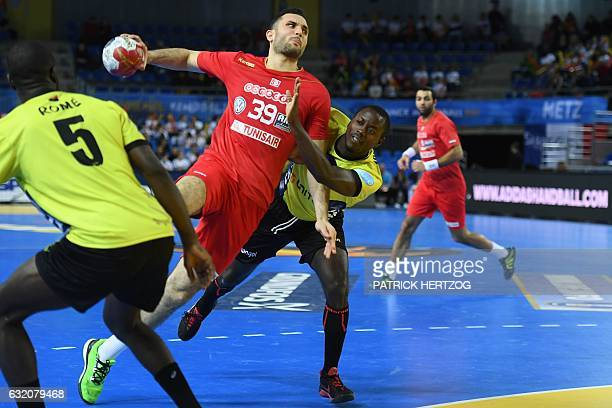 Tunisia's centre back Mohamed Soussi jumps to shoot on goal during the 25th IHF Men's World Championship 2017 Group B handball match Tunisia vs...