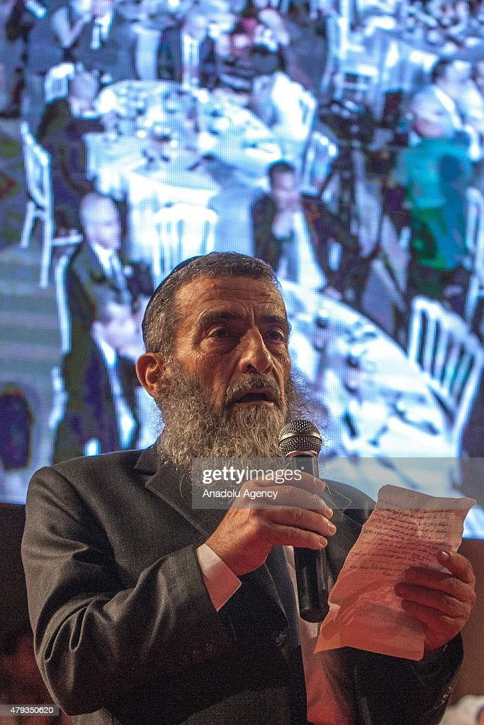 Tunisia's Chief Rabbi Haim Bitan speaks during Iftar the evening meal with which Muslims break their fast during the holy month of Ramadan hosted by...