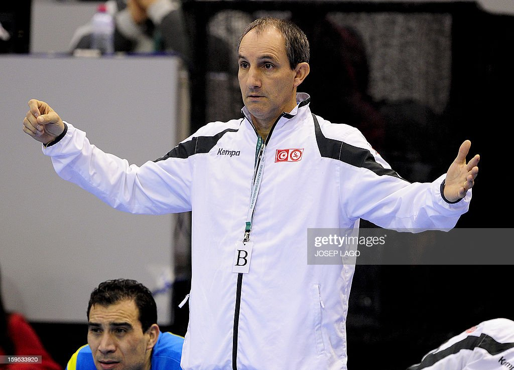 Tunisia's coach Alain Portes gestures during the 23rd Men's Handball World Championships preliminary round Group A match Tunisia vs Montenegro at the Palacio de los Deportes de Granollers on January 15, 2013.