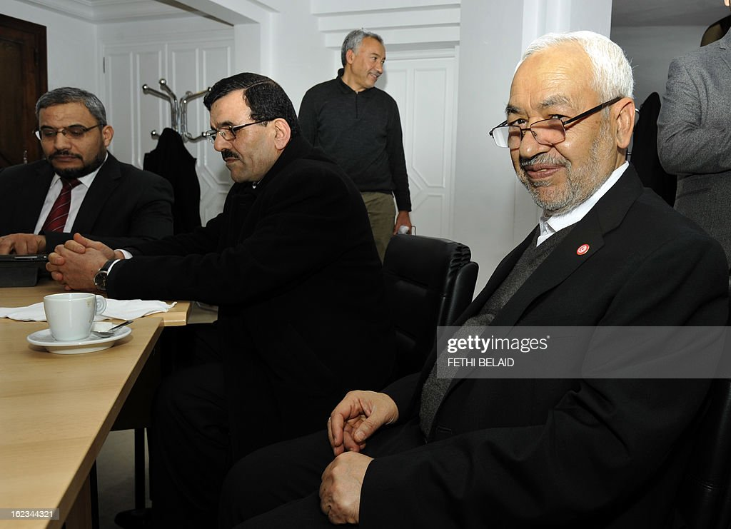 Tunisia's Ennahda ruling party's leader, Rached Ghannouchi (R) poses near Interior Minister Ali Larayedh before a meeting at the party's headquarters on February 22, 2013 in Tunis. Ennahda has tapped Larayedh as its candidate to replace Prime Minister Hamadi Jebali, who resigned this week amid a major political crisis, the party said. AFP PHOTO / FETHI BELAID