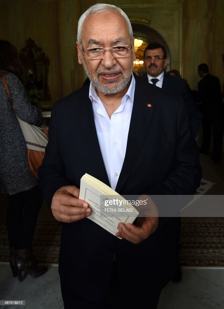 Tunisia's Ennahdha Islamist party leader Rached Ghannouchi attends a ceremony marking the 59th anniversary of independance on March 20, 2015 in Tunis, two days after gunmen opened fire at visitors during an attack at the Bardo national museum. The Islamic State (IS) jihadist group claimed responsibility for the attack that killed at least 21 people. AFP PHOTO / FETHI BELAID
