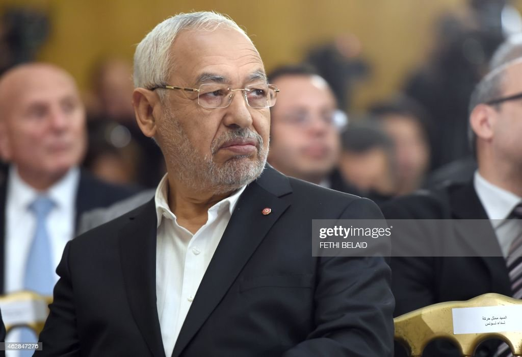 Tunisia's Ennahdha Islamist Party Leader Rached Ghannouchi looks on during a handover ceremony attended by the country's newly elected government in Tunis on February 6, 2015. A secular-led coalition government that includes Islamists took office in Tunisia, three months after the North African state's first free parliamentary elections.