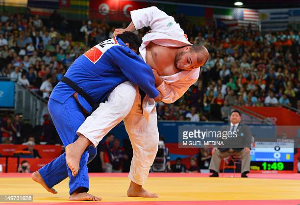 Tunisia's Faicel Jaballah competes with Kazakhstan's Yerzhan Shynkeyev during their men's 100kg judo contest match of the London 2012 Olympic Games...