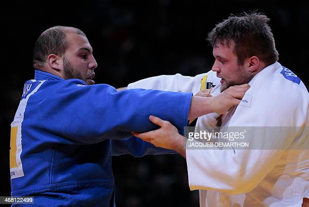 Tunisia's Faicel Jaballah fights against Germany's Andre Breitbarth during their bronze medal bout in the 100kg category at the 2014 Paris Judo Grand...