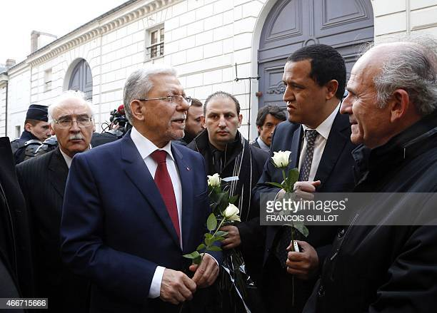 Tunisia's Foreign minister Taieb Baccouche speaks with Imam of the municipal Drancy mosque in SeineSaintDenis Hassen Chalghoumi on March 18 mars 2015...